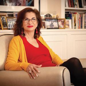 Adrian Leeds sitting in her Paris apartment