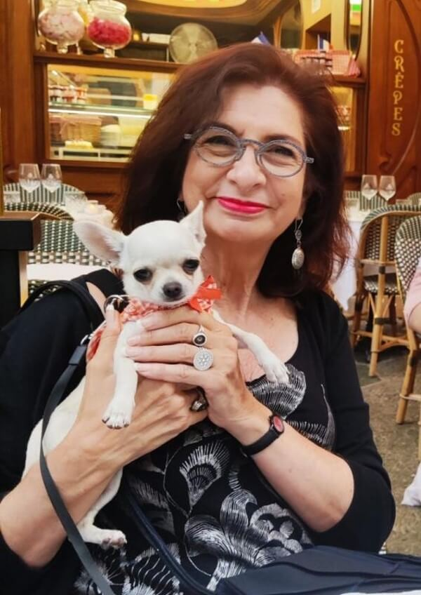 Adrian Leeds at a café in Nice with Simone, her god-chienne